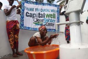 The Water Project: Lokomasama, Kalangba Junction, Next to Alimamy Musa Kamara's House -  Young Lady Happily Drinking