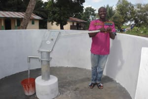 The Water Project: Kamasondo, Robay Village, Next to Mosque -  Community Headman Collecting Water