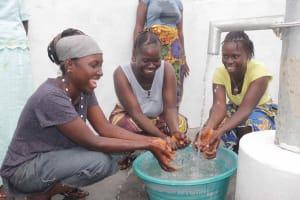 The Water Project: Kamasondo, Robay Village, Next to Mosque -  Women Happily Splashing