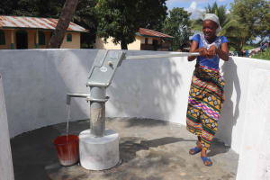 The Water Project: Kamasondo, Robay Village, Next to Mosque -  Collecting Safe Water