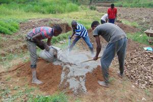 The Water Project: Mukangu Community, Mukasia Spring -  Community Members Assist