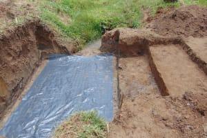 The Water Project: Mukangu Community, Mukasia Spring -  Slab Setting