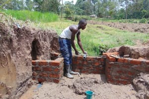 The Water Project: Mukangu Community, Mukasia Spring -  Pipe Setting