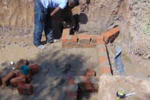 The Water Project: Mukangu Community, Mukasia Spring -  Wall Construction