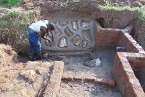 The Water Project: Mukangu Community, Mukasia Spring -  Pitching Stones