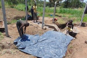 The Water Project: Mukangu Community, Mukasia Spring -  Backfilling Plastic