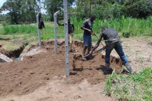 The Water Project: Mukangu Community, Mukasia Spring -  Backfilling Soil