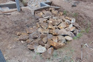 The Water Project: Mukangu Community, Mukasia Spring -  Backfilling Stone