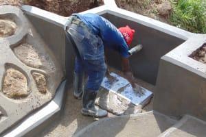 The Water Project: Mukangu Community, Mukasia Spring -  Laying Tiles
