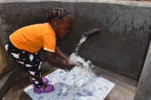 The Water Project: Mukangu Community, Mukasia Spring -  Filling A Glass