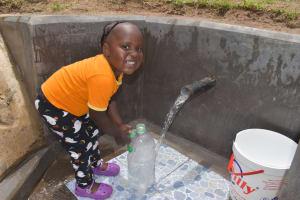 The Water Project: Mukangu Community, Mukasia Spring -  Smiling Customer