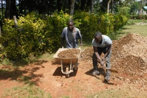 The Water Project: Gimomoi Primary School -  Community Members Assist