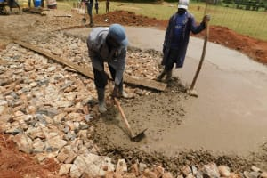 The Water Project: Gimomoi Primary School -  Spreading Concrete