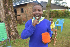 The Water Project: Gimomoi Primary School -  Mitchel Brushing Teeth