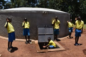 The Water Project: Gimomoi Primary School -  Students At Tank