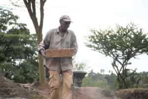 The Water Project: Kyamwalye Community -  Bringing Materials