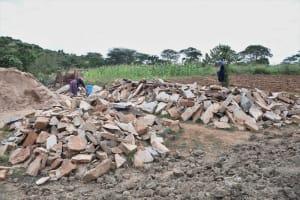 The Water Project: Kyamwalye Community -  Piles Of Stone