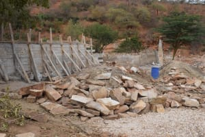 The Water Project: Kyamwalye Community -  Stone Pile Is Smaller