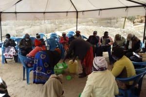 The Water Project: Kyamwalye Community -  Adding Water To Soap