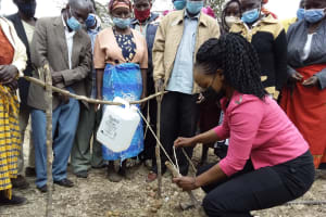 The Water Project: Kyamwalye Community -  Constructing Tippy Tap