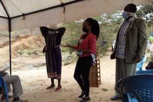 The Water Project: Kyamwalye Community -  Donning Mask