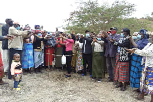 The Water Project: Kyamwalye Community -  Scrubbing Between Fingers