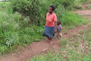 The Water Project: Kyabagabu Community -  Beatrice Nyakake Walking Home