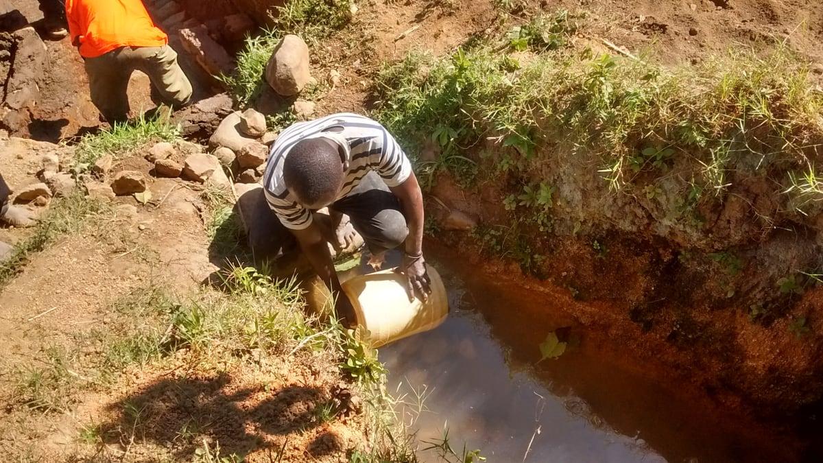 8 kenya4705 Mr. Columba fetching water for construction