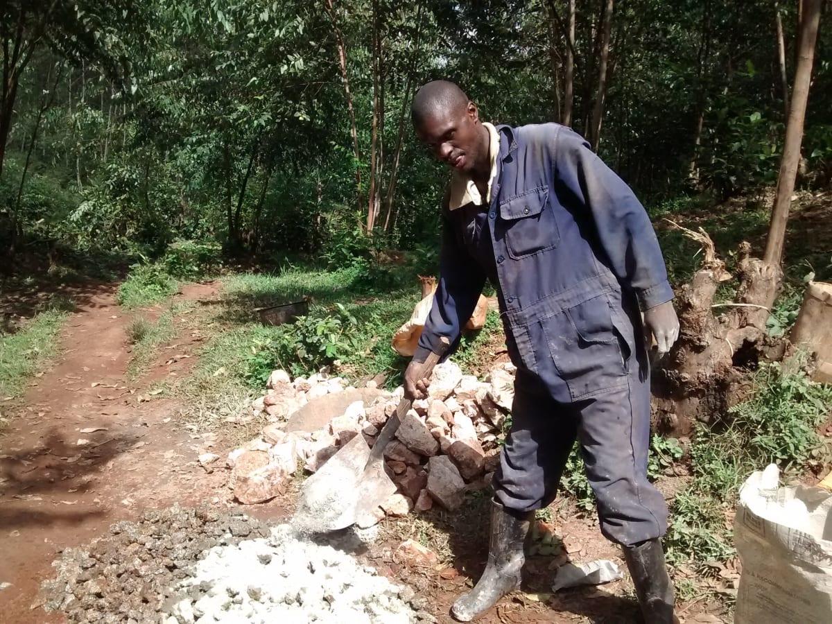 11 kenya4716 Mr. Anziva helping the artisan