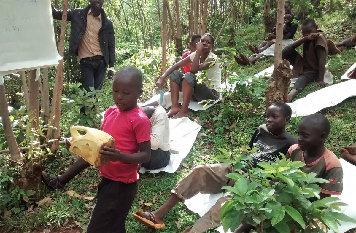 3 kenya4716 Patrick Vudoti explains how the community cleans water jerrycans