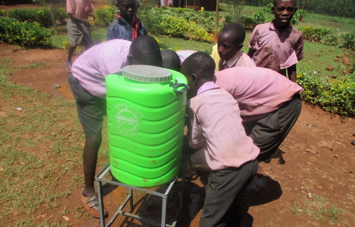 4 kenya4662 students trying the hand-washing station during training