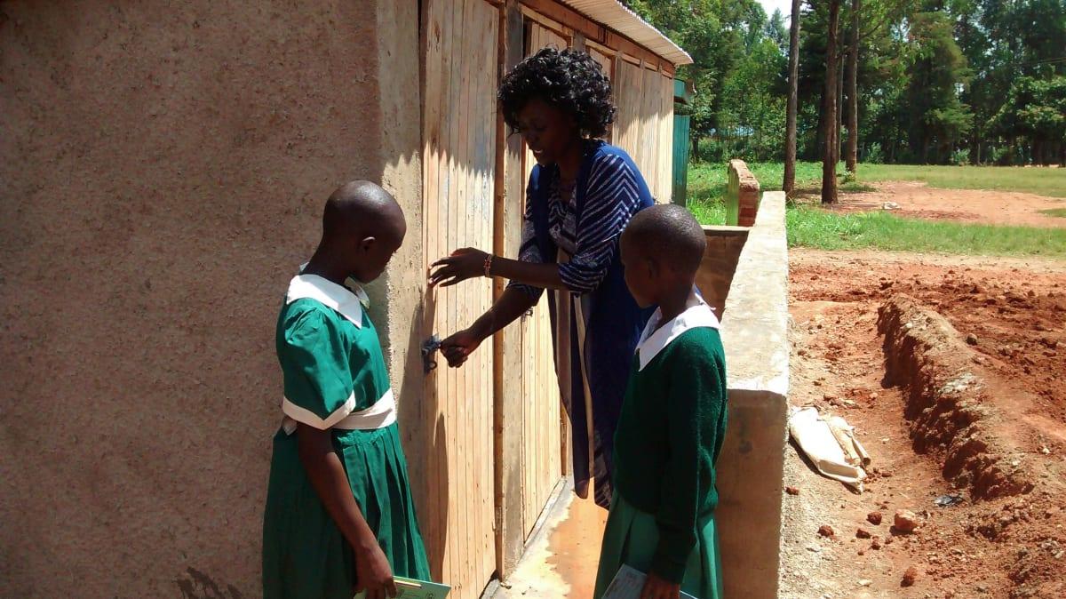 6 kenya4668 girls learning about latrine use