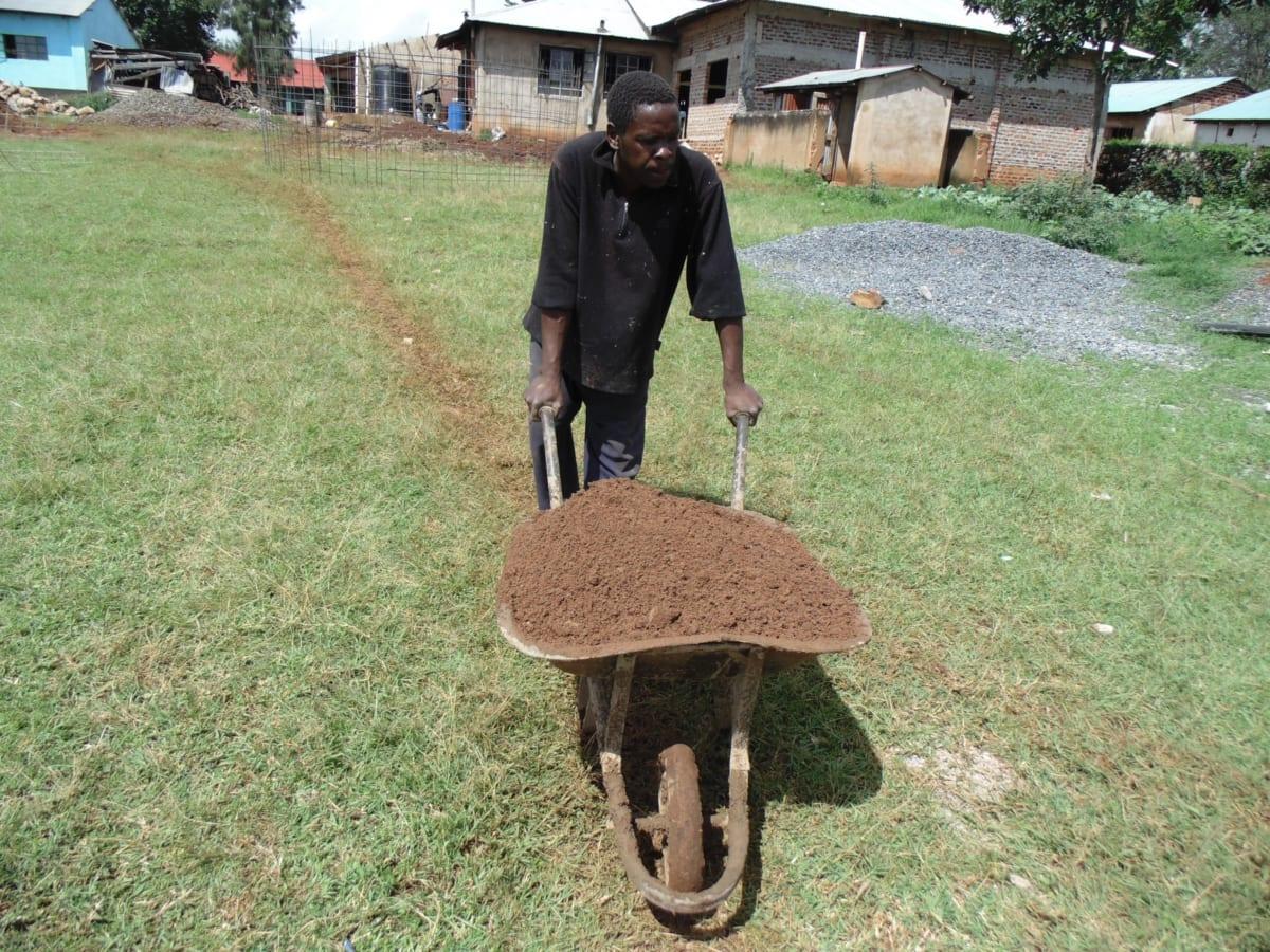 7 kenya4667 a community member brings materials to construction site
