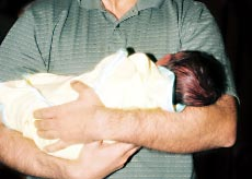 A father with his baby, The CSA, Guilty until proven innocent.
