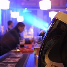 A bar, guinness, man drinking