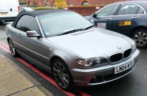 A BMW parked in a stupid place at Heartlands Hospital, Birmingham