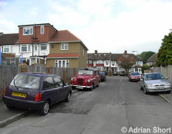 Cars parked on the pavement