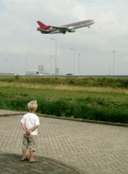 A child watching a plane take off