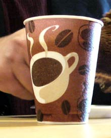 A disposable coffee cup