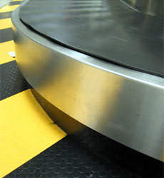 An empty baggage carousel, airport baggage reclaim