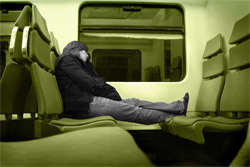 Feet on a seat on a train