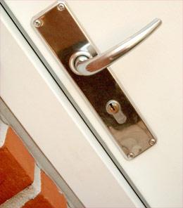 Door handle - the busybody neighbour poking her nose in?