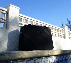 Luggage by the swimming pool