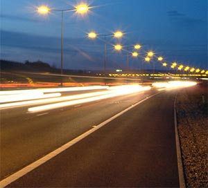 Traffic at night on the M25, middle lane drivers
