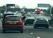 A motorway, information boards