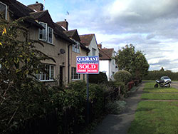Moving home has taken a year, a house sold sign