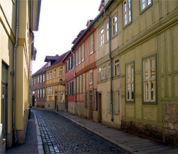 A narrow street with narrow pavements