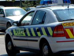 A police car driving through town