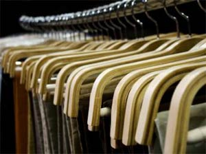 Clothes rack in a clothing retail store, piped music annoying customers