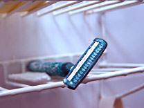 Shaving woes, a razor on a shower tray